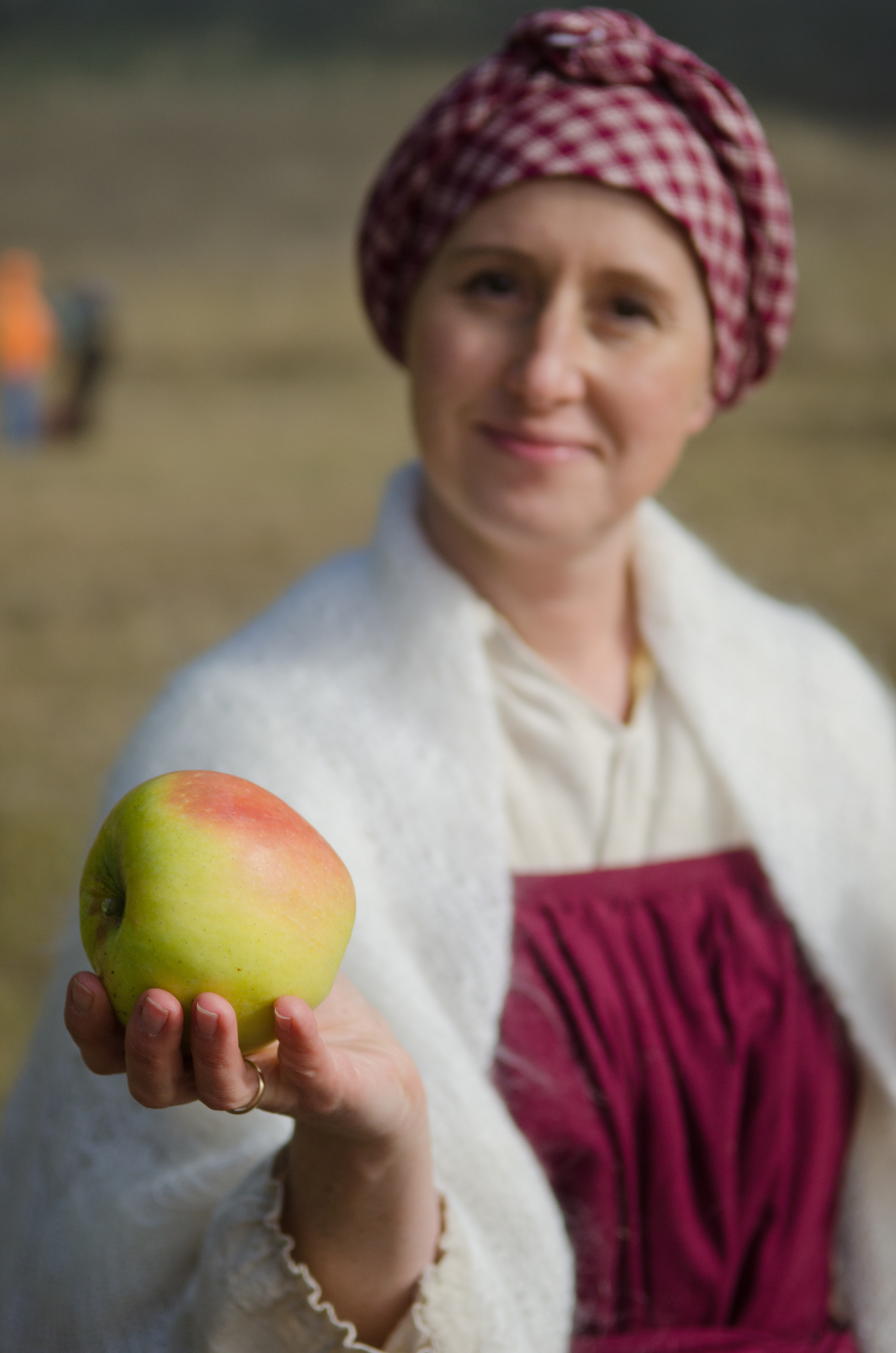 Woman Offering an Heirloom Apple Fort Ross Orchard